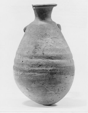 Jar with Grotesque Face (of Bes?). Clay, slip, 7 1/2 x Diam. 4 5/8 in. (19.1 x 11.7 cm). Brooklyn Museum, Charles Edwin Wilbour Fund, 07.447.478. Creative Commons-BY