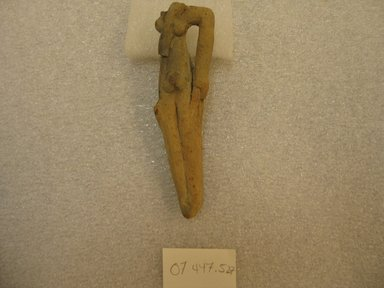 Fragment of Figurine of Woman. Pottery, 4 3/16 x 1 x 15/16 in. (10.7 x 2.6 x 2.4 cm). Brooklyn Museum, Charles Edwin Wilbour Fund, 07.447.527. Creative Commons-BY
