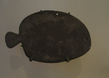 Fish-Shaped Palette, ca. 3400-3200 B.C.E. Graywacke, 6 11/16 x 4 1/8 in. (17 x 10.5 cm). Brooklyn Museum, Charles Edwin Wilbour Fund, 07.447.611. Creative Commons-BY