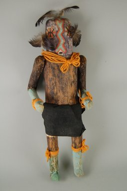 She-we-na (Zuni Pueblo) (Native American). Kachina Doll, (Kjna E Lona), late 19th century. Wood, cloth, pigment, feathers, 5 7/16 x 4 1/16 x 15 1/16in. (13.8 x 10.3 x 38.3cm). Brooklyn Museum, Museum Expedition 1907, Museum Collection Fund, 07.467.8421. Creative Commons-BY