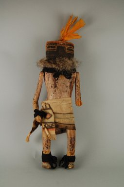 She-we-na (Zuni Pueblo) (Native American). Kachina Doll (Mokjachepa), late 19th century. Wood, hide, feather, cotton, pigment, fur, 13 3/8 x 2 15/16 x 4 13/16in. (34 x 7.5 x 12.2cm). Brooklyn Museum, Museum Expedition 1907, Museum Collection Fund, 07.467.8424. Creative Commons-BY