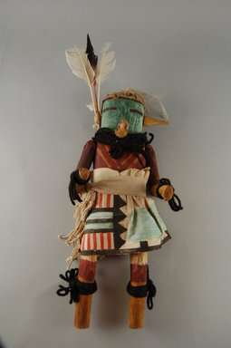 She-we-na (Zuni Pueblo) (Native American). Kachina Doll (Muluk Takja), 1868-1900, late 19th century. Wood, feather, cotton, pigment, paper, wool yarn, 12 5/8 x 4 13/16 x 3 1/8in. (32 x 12.3 x 8cm). Brooklyn Museum, Museum Expedition 1907, Museum Collection Fund, 07.467.8435. Creative Commons-BY