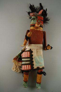 She-we-na (Zuni Pueblo) (Native American). Kachina Doll (Etatza Pona), late 19th century. Wood, cloth, feather, pigment, 4 5/8 x 3 11/16 x 15 1/4in. (11.7 x 9.4 x 38.7cm). Brooklyn Museum, Museum Expedition 1907, Museum Collection Fund, 07.467.8436. Creative Commons-BY