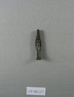 Figure of Isis Standing as Amulet. Faience, 1 1/2 x 5/16 x 7/16 in. (3.8 x 0.8 x 1.1 cm). Brooklyn Museum, Charles Edwin Wilbour Fund, 08.480.127. Creative Commons-BY