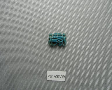 Divine - Eye as Amulet. Faience, 7/16 x 3/16 x 5/8 in. (1.1 x 0.5 x 1.6 cm). Brooklyn Museum, Charles Edwin Wilbour Fund, 08.480.144. Creative Commons-BY