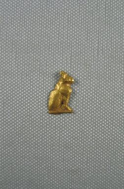 Amulet - Seated Cat. Sheet gold, 3/4 x 7/16 in. (1.9 x 1.2 cm). Brooklyn Museum, Charles Edwin Wilbour Fund, 08.480.211. Creative Commons-BY