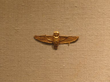 Amulet Representing the Ba-bird, ca. 664-30 B.C.E. Gold, 11/16 x 1 3/4 in. (1.7 x 4.5 cm). Brooklyn Museum, Charles Edwin Wilbour Fund, 08.480.213. Creative Commons-BY