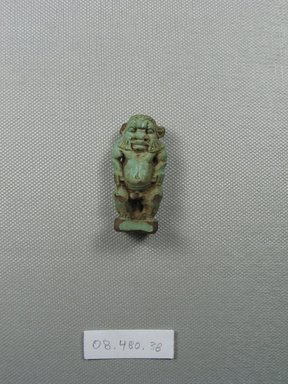 Small Figure of Bes. Faience, 1 7/8 x 7/8 in. (4.7 x 2.3 cm). Brooklyn Museum, Charles Edwin Wilbour Fund, 08.480.88. Creative Commons-BY