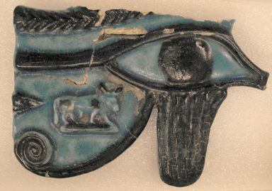 Large Eye Amulet, 664–332 B.C.E. Faience, 3 1/2 x 5 1/8 x 9/16 in. (8.9 x 13 x 1.4 cm). Brooklyn Museum, 09.877. Creative Commons-BY