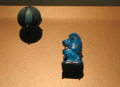 Game Piece in Form of an Ape, ca. 1539-1390 B.C.E. Faience, painted, 1 7/8 x 1 1/8 in. (4.7 x 2.8 cm). Brooklyn Museum, Charles Edwin Wilbour Fund, 36.125. Creative Commons-BY