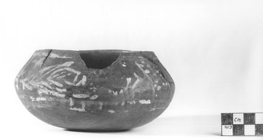 Flat Urn. Pottery, painted, 2 11/16 x 5 11/16 in. (6.8 x 14.4 cm). Brooklyn Museum, Charles Edwin Wilbour Fund, 09.889.443. Creative Commons-BY