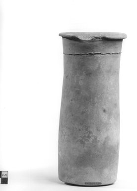Wavy Handled Cylindrical Vase. Terracotta, 9 3/16 x 4 1/2 in. (23.3 x 11.5 cm). Brooklyn Museum, Charles Edwin Wilbour Fund, 09.889.705. Creative Commons-BY