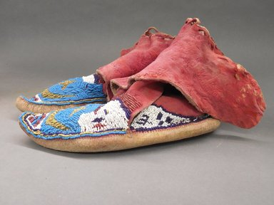 Pair of Moccasins, late nineteenth early twentieth century. Hide, dye, beads Brooklyn Museum, Purchased with funds given by Herman Stutzer, 10.229.4a-b