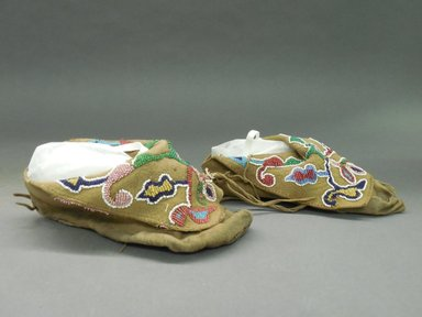 Pair of Moccasins, late 19th-early 20th century. Hide, beads Brooklyn Museum, Purchased with funds given by Herman Stutzer, 10.229.5a-b