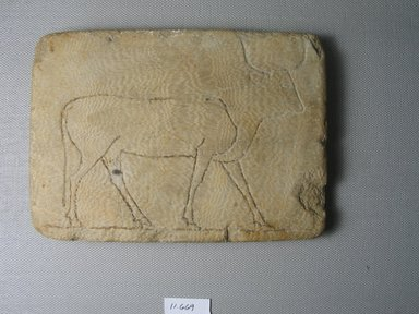 Oblong Plaque with Figure of a Cow. Alabaster, 6 1/8 x 11/16 x 4 3/8 in. (15.5 x 1.7 x 11.1 cm). Brooklyn Museum, Museum Collection Fund, 11.669. Creative Commons-BY