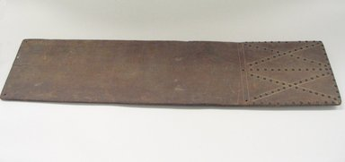 Osage (Native American). Cradle Board, late 19th-early 20th century. Walnut, brass tacks, 10 x 41 in. (25.4 x 104.1 cm). Brooklyn Museum, Museum Expedition 1911, Museum Collection Fund, 11.694.9007. Creative Commons-BY