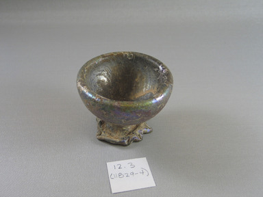 Roman. Cup of Molded Glass, 1st century A.D. Glass, 2 7/16 x 2 7/8 in. (6.2 x 7.3 cm). Brooklyn Museum, Gift of Aziz Khayat, 12.3. Creative Commons-BY