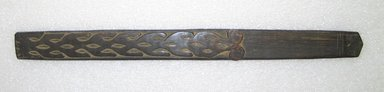 Ainu. Curved Prayer Stick. Wood, 1 1/8 x 12 3/16 in. (2.8 x 31 cm). Brooklyn Museum, Gift of Herman Stutzer, 12.334. Creative Commons-BY