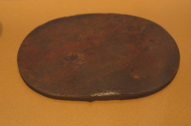 Mirror Disk, ca. 1938-1700 B.C.E. Bronze, 3 11/16 x 4 3/8 in. (9.4 x 11.1 cm). Brooklyn Museum, Gift of the Egypt Exploration Fund, 13.1043. Creative Commons-BY