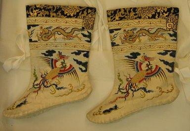 Pair of Manchu Woman's Court Socks, 19th century. Silk with silk and gold embroidery, 8 7/8 x 10 5/8 in. (22.5 x 27 cm). Brooklyn Museum, 13.149a-b. Creative Commons-BY