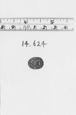 Scarab with Winged Disk and Lotus. Faience or steatite, 1/4 x 7/16 x 5/8 in. (0.7 x 1.1 x 1.6 cm). Brooklyn Museum, Gift of the Egypt Exploration Fund, 14.624. Creative Commons-BY