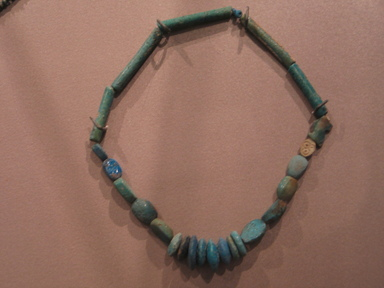 Single Strand Necklace with Bead and 5 Scarabs, ca. 1390-1292 B.C.E. Faience, Overall Length: 12 5/8 in. (32 cm). Brooklyn Museum, Gift of the Egypt Exploration Fund, 15.498. Creative Commons-BY