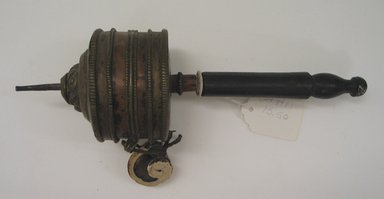 Small Hand Prayer Wheel, 19th century. Metal, 12 1/8 x 3 7/16 in. (30.8 x 8.7 cm). Brooklyn Museum, Brooklyn Museum Collection, 15.50. Creative Commons-BY