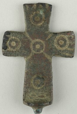 Coptic. Cross, 5th century C.E. Bronze, 1 5/16 x 1/8 x 2 1/4 in. (3.4 x 0.3 x 5.7 cm). Brooklyn Museum, Gift of Evangeline Wilbour Blashfield, Theodora Wilbour, and Victor Wilbour honoring the wishes of their mother, Charlotte Beebe Wilbour, as a memorial to their father, Charles Edwin Wilbour, 16.134. Creative Commons-BY