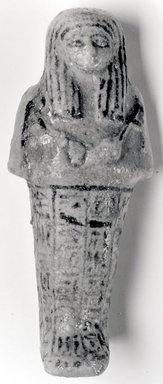 Ushabti, ca. 1075-945 B.C.E. Faience, height: 5 5/16 in. (13.5 cm); width at elbows: 2 5/16 in. (5.9 cm). Brooklyn Museum, Gift of Evangeline Wilbour Blashfield, Theodora Wilbour, and Victor Wilbour honoring the wishes of their mother, Charlotte Beebe Wilbour, as a memorial to their father, Charles Edwin Wilbour, 16.181. Creative Commons-BY