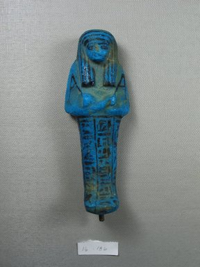 Ushabti, ca. 1075-945 B.C.E. Faience, height: 5 13/16 in. (14.7 cm); width at elbows: 2 1/4 in. (5.7 cm). Brooklyn Museum, Gift of Evangeline Wilbour Blashfield, Theodora Wilbour, and Victor Wilbour honoring the wishes of their mother, Charlotte Beebe Wilbour, as a memorial to their father, Charles Edwin Wilbour, 16.186. Creative Commons-BY