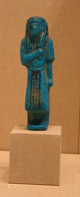 Funerary Figurine of Nesikhonsu, ca. 1075-945 B.C.E. Faience, 6 7/16 x  width at elbows 1 15/16 in. (16.4 x 4.9 cm). Brooklyn Museum, Gift of Evangeline Wilbour Blashfield, Theodora Wilbour, and Victor Wilbour honoring the wishes of their mother, Charlotte Beebe Wilbour, as a memorial to their father, Charles Edwin Wilbour, 16.187. Creative Commons-BY