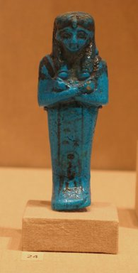 Funerary Figurine of Queen Maatkare, ca. 1075-945 B.C.E. Faience, 4 11/16 x  width at elbows 1 5/8 in. (11.9 x 4.2 cm). Brooklyn Museum, Gift of Evangeline Wilbour Blashfield, Theodora Wilbour, and Victor Wilbour honoring the wishes of their mother, Charlotte Beebe Wilbour, as a memorial to their father, Charles Edwin Wilbour, 16.191. Creative Commons-BY