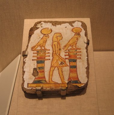 Painting of a Standing King, ca. 1539-1070 B.C.E. Mud, plaster, pigment, 5 5/16 x 1 5/16 x 4 5/16 in. (13.5 x 3.4 x 11 cm). Brooklyn Museum, Gift of Evangeline Wilbour Blashfield, Theodora Wilbour, and Victor Wilbour honoring the wishes of their mother, Charlotte Beebe Wilbour, as a memorial to their father, Charles Edwin Wilbour, 16.208. Creative Commons-BY