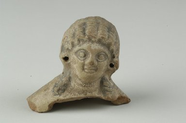Female Head. Terracotta, slipped and painted, 2 7/16 x 2 11/16 x 1 13/16 in. (6.2 x 6.8 x 4.6 cm). Brooklyn Museum, Gift of Evangeline Wilbour Blashfield, Theodora Wilbour, and Victor Wilbour honoring the wishes of their mother, Charlotte Beebe Wilbour, as a memorial to their father, Charles Edwin Wilbour, 16.232. Creative Commons-BY