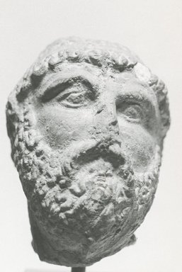 Graeco-Egyptian. Male Portrait Head, 3rd-2nd century B.C.E. Terracotta, 2 1/16 x 1 9/16 in. (5.2 x 3.9 cm). Brooklyn Museum, Gift of Evangeline Wilbour Blashfield, Theodora Wilbour, and Victor Wilbour honoring the wishes of their mother, Charlotte Beebe Wilbour, as a memorial to their father, Charles Edwin Wilbour, 16.234. Creative Commons-BY