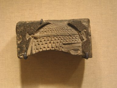 Fragmentary Relief of a King, ca. 664-525 B.C.E. Basalt, 2 11/16 x 5 1/2 x 2 in. (6.8 x 13.9 x 5.1 cm). Brooklyn Museum, Gift of Evangeline Wilbour Blashfield, Theodora Wilbour, and Victor Wilbour honoring the wishes of their mother, Charlotte Beebe Wilbour, as a memorial to their father, Charles Edwin Wilbour, 16.237. Creative Commons-BY