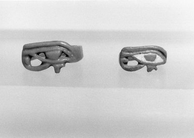 Finger Ring, Wedjat-Eye on Bezel. Faience, 3/8 x 13/16 x 13/16 in. (0.9 x 2.1 x 2 cm). Brooklyn Museum, Gift of Evangeline Wilbour Blashfield, Theodora Wilbour, and Victor Wilbour honoring the wishes of their mother, Charlotte Beebe Wilbour, as a memorial to their father, Charles Edwin Wilbour, 16.355. Creative Commons-BY
