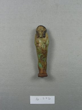 Ushabti, ca. 1075-656 B.C.E. Faience, height: 2 13/16 in. (7.2 cm); width at elbows: 7/8 in. (2.2 cm). Brooklyn Museum, Gift of Evangeline Wilbour Blashfield, Theodora Wilbour, and Victor Wilbour honoring the wishes of their mother, Charlotte Beebe Wilbour, as a memorial to their father, Charles Edwin Wilbour, 16.373. Creative Commons-BY