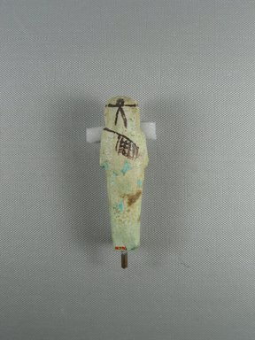 Ushabti, ca. 1075-656 B.C.E. Faience, height: 3 11/16 in. (9.3 cm); width: 1 1/8 in. (2.9 cm). Brooklyn Museum, Gift of Evangeline Wilbour Blashfield, Theodora Wilbour, and Victor Wilbour honoring the wishes of their mother, Charlotte Beebe Wilbour, as a memorial to their father, Charles Edwin Wilbour, 16.376. Creative Commons-BY