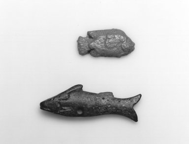 Fish as Amulet. Faience, 1/2 x 1 1/16 in. (1.3 x 2.7 cm). Brooklyn Museum, Gift of Evangeline Wilbour Blashfield, Theodora Wilbour, and Victor Wilbour honoring the wishes of their mother, Charlotte Beebe Wilbour, as a memorial to their father Charles Edwin Wilbour, 16.580.104. Creative Commons-BY