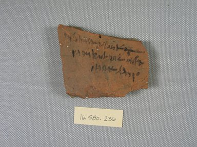 Demotic Ostracon, Year 13 of a Ptolemy. Terracotta, pigment, 2 1/16 x 5/16 x 2 7/16 in. (5.3 x 0.8 x 6.2 cm). Brooklyn Museum, Gift of Evangeline Wilbour Blashfield, Theodora Wilbour, and Victor Wilbour honoring the wishes of their mother, Charlotte Beebe Wilbour, as a memorial to their father, Charles Edwin Wilbour, 16.580.236. Creative Commons-BY