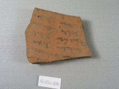 Demotic Ostracon. Terracotta, pigment, 3 1/16 x 7/16 x 3 13/16 in. (7.8 x 1.1 x 9.7 cm). Brooklyn Museum, Gift of Evangeline Wilbour Blashfield, Theodora Wilbour, and Victor Wilbour honoring the wishes of their mother, Charlotte Beebe Wilbour, as a memorial to their father, Charles Edwin Wilbour, 16.580.254. Creative Commons-BY