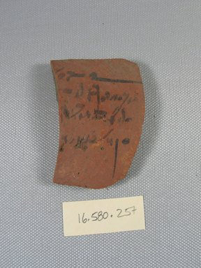 Demotic Ostracon, Year six of a Ptolemy. Terracotta, pigment, 1 7/8 x 5/16 x 2 5/8 in. (4.8 x 0.8 x 6.7 cm). Brooklyn Museum, Gift of Evangeline Wilbour Blashfield, Theodora Wilbour, and Victor Wilbour honoring the wishes of their mother, Charlotte Beebe Wilbour, as a memorial to their father, Charles Edwin Wilbour, 16.580.257. Creative Commons-BY