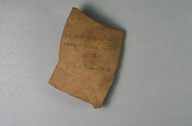 Demotic Ostracon, Year 32 of Augustus. Terracotta, pigment, 3 3/16 x 3/8 x 3 7/8 in. (8.1 x 0.9 x 9.9 cm). Brooklyn Museum, Gift of Evangeline Wilbour Blashfield, Theodora Wilbour, and Victor Wilbour honoring the wishes of their mother, Charlotte Beebe Wilbour, as a memorial to their father, Charles Edwin Wilbour, 16.580.259. Creative Commons-BY