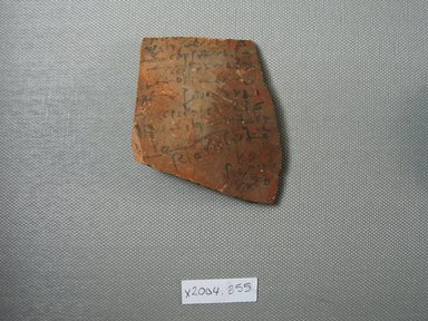 Demotic. Demotic Ostracon. Terracotta, pigment, 2 3/8 x 1/4 x 2 15/16 in. (6.1 x 0.6 x 7.5 cm). Brooklyn Museum, Gift of Evangeline Wilbour Blashfield, Theodora Wilbour, and Victor Wilbour honoring the wishes of their mother, Charlotte Beebe Wilbour, as a memorial to their father, Charles Edwin Wilbour, 16.580.566. Creative Commons-BY