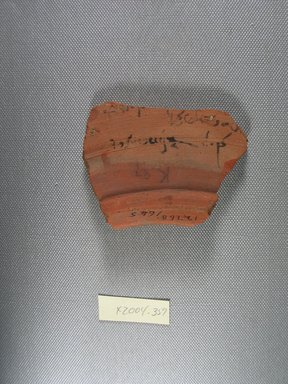 Demotic. Demotic Ostracon, Year 9 of a late ? Ptolemy. Terracotta, pigment, 2 1/2 x 9/16 x 3 1/4 in. (6.4 x 1.5 x 8.3 cm). Brooklyn Museum, Gift of Evangeline Wilbour Blashfield, Theodora Wilbour, and Victor Wilbour honoring the wishes of their mother, Charlotte Beebe Wilbour, as a memorial to their father, Charles Edwin Wilbour, 16.580.568. Creative Commons-BY
