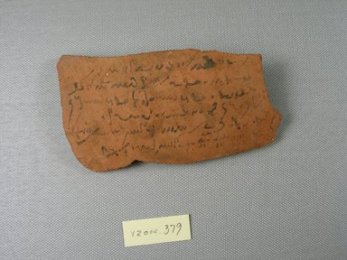 Demotic. Demotic Ostracon, Year 2 of Tiberius. Terracotta, pigment, 2 11/16 x 1/4 x 4 13/16 in. (6.9 x 0.7 x 12.3 cm). Brooklyn Museum, Gift of Evangeline Wilbour Blashfield, Theodora Wilbour, and Victor Wilbour honoring the wishes of their mother, Charlotte Beebe Wilbour, as a memorial to their father, Charles Edwin Wilbour, 16.580.590. Creative Commons-BY