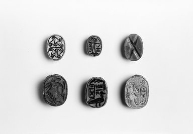 Scarab of Amunhotep II. Steatite, glazed, length: (1.7 cm). Brooklyn Museum, Gift of Evangeline Wilbour Blashfield, Theodora Wilbour, and Victor Wilbour honoring the wishes of their mother, Charlotte Beebe Wilbour, as a memorial to their father, Charles Edwin Wilbour, 16.423. Creative Commons-BY