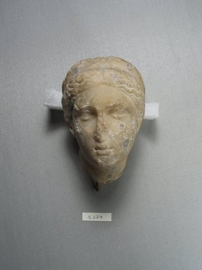 Head of a Woman, later than the 4th century B.C.E. Marble, 4 7/16 x 3 3/16 x 3 3/8 in. (11.2 x 8.1 x 8.5 cm). Brooklyn Museum, Gift of Evangeline Wilbour Blashfield, Theodora Wilbour, and Victor Wilbour honoring the wishes of their mother, Charlotte Beebe Wilbour, as a memorial to their father, Charles Edwin Wilbour, 16.629. Creative Commons-BY