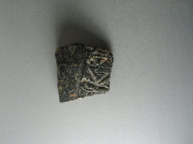 Fragment Retaining One Worked Surface, ca. 1352-1336 B.C.E. Granite, 2 x 2 1/16 in. (5.1 x 5.3 cm). Brooklyn Museum, Gift of Evangeline Wilbour Blashfield, Theodora Wilbour, and Victor Wilbour honoring the wishes of their mother, Charlotte Beebe Wilbour, as a memorial to their father, Charles Edwin Wilbour, 16.732. Creative Commons-BY